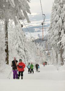 Skiarena - Personen im Lift